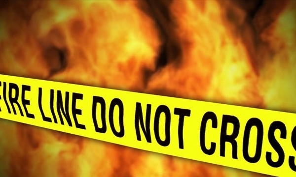 Fire and police tape wide_1529002922173.jpg.jpg