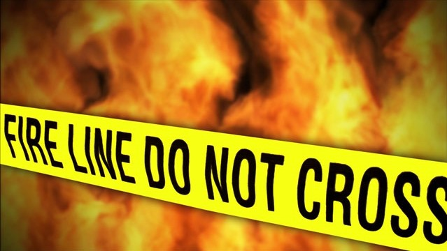 Fire and police tape wide_1529002922173.jpg.jpg