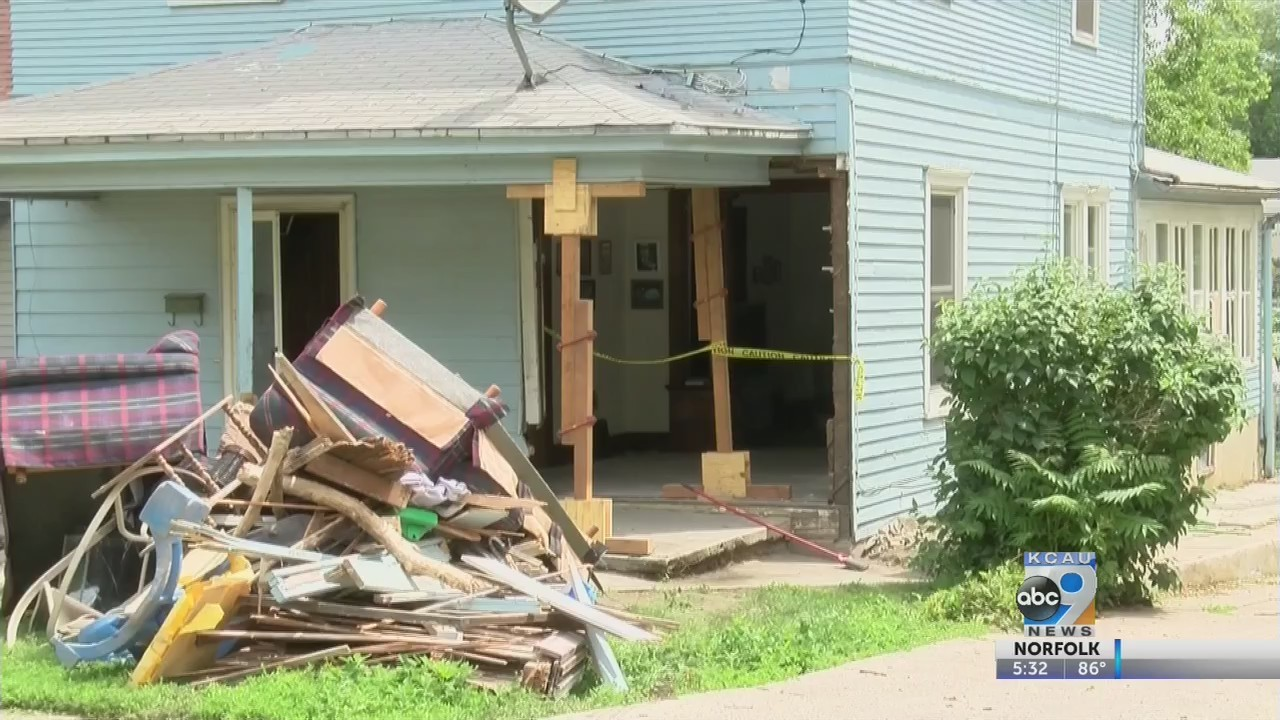 Women arrested after hitting house with SUV then fleeing scene