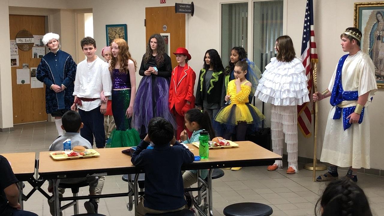 "Digital Exclusive: Holy Cross students visit elementary schools as ""Little Mermaid"" characters"